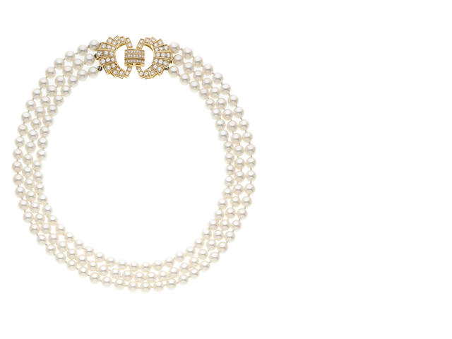A three-strand cultured pearl and diamond clasp necklace