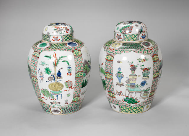 A pair of oviform vases and covers Kangxi