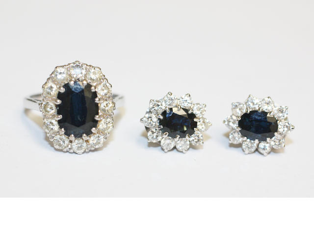 A sapphire and diamond cluster ring and a matching pair of earstuds, (2)
