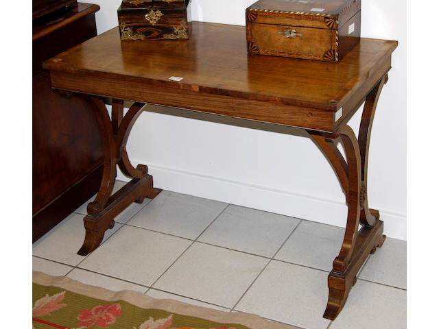 A pair of Regency style rosewood and crossbanded centre tables