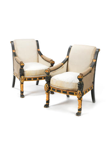 A pair of Regency later green painted and parcel-gilt mahogany bergères in the manner of George Smith
