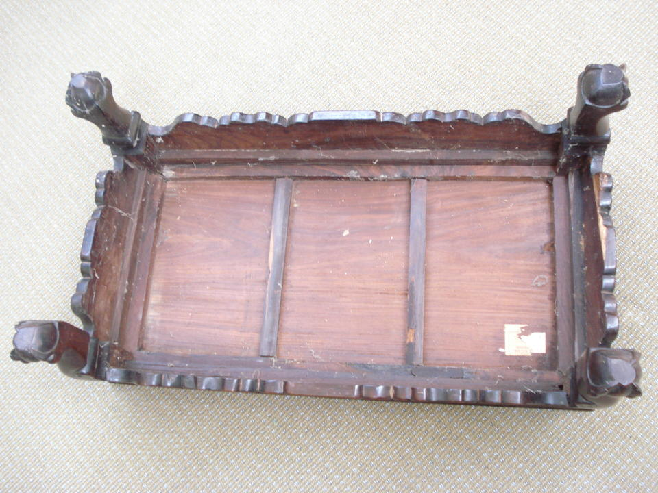 A hardwood low table Qing