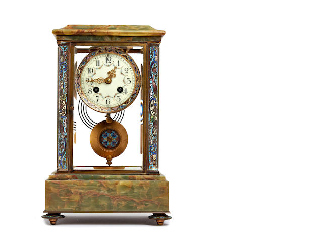 A 19th Century French champleve enamel and green onyx decorated four glass mantel clock  Anonymous