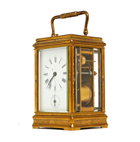 A 19th century French gilt brass carriage clock with half hour repeat and alarm Anonymous No. 1646