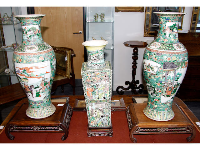 A Famille vert vase and stand together with a pair famille vert vases