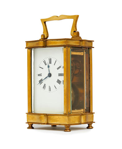 A late 19th century french brass Doucine style carriage timepiece Anonymous