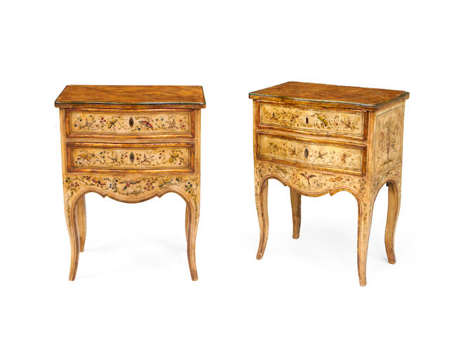 A matched pair of Italian cream painted and polychrome decorated commodinos in the mid 18th century style