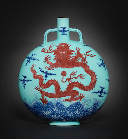 A magnificent and rare Imperial blue and copper-red turquoise-glazed 'dragon' moonflask, bianhu Qianlong seal mark and of the period