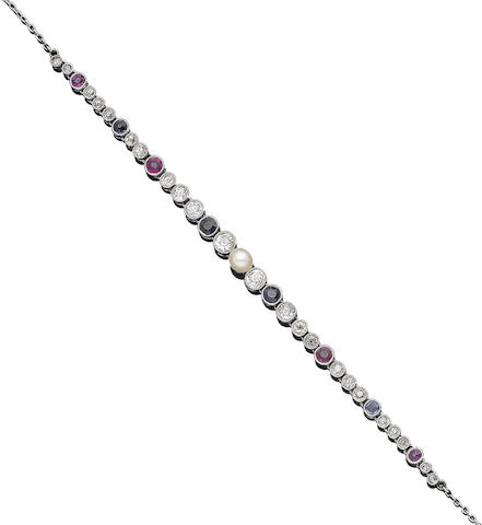 An early 20th century pearl, ruby, sapphire and diamond necklace