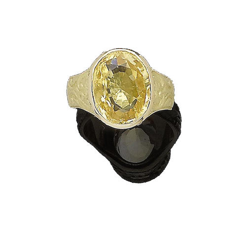 A yellow sapphire and diamond-set ring