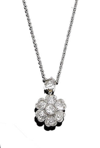 A diamond cluster pendant necklace