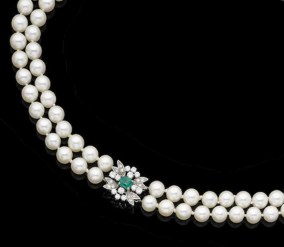 A double-strand cultured pearl necklace with emerald and diamond clasp