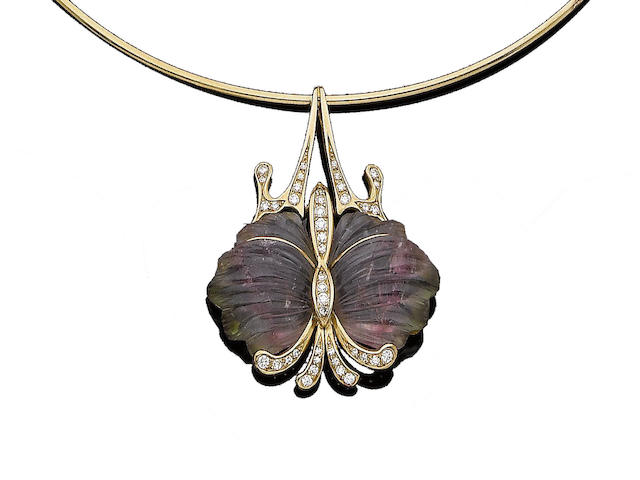 A tourmaline and diamond pendent necklace
