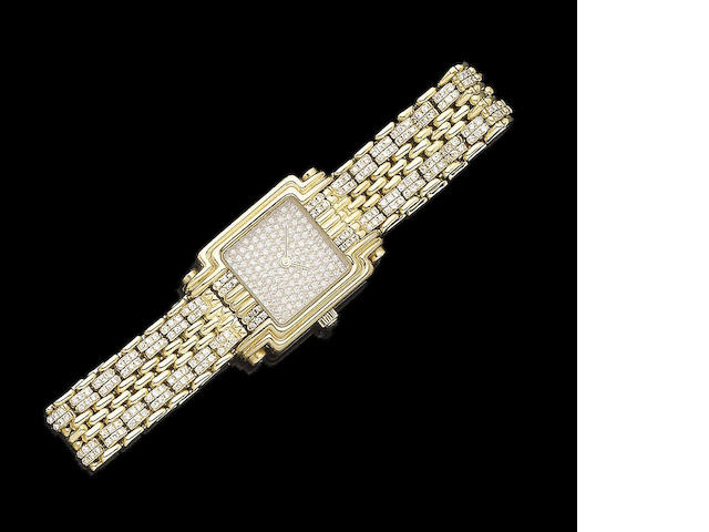 A gold and diamond-set wristwatch, by Boucheron