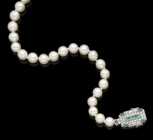 A single-strand cultured pearl necklace and gem-set clasp