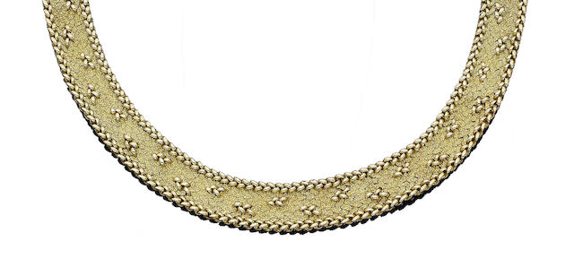A gold collar necklace, by Roy King,