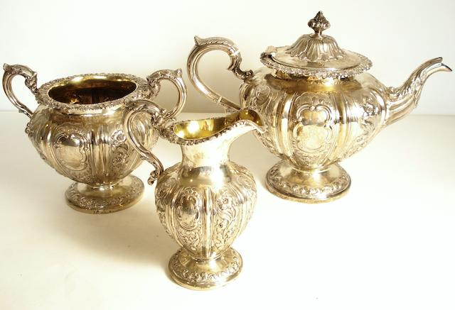 A composite silver three piece tea service The teapot by W.Cunningham, the cream jug and sugar bowl by Mackay & Chisholm, Edinburgh 1847