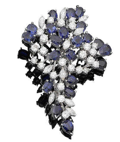 A sapphire and diamond floral brooch