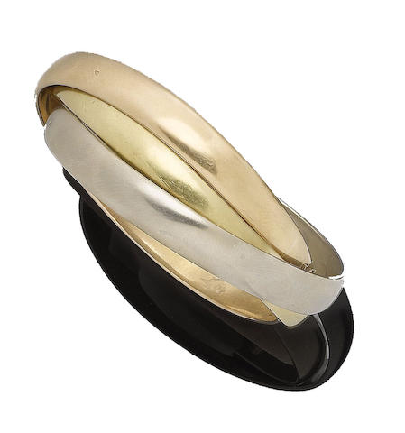 A 'Trinity' bangle, by Cartier,