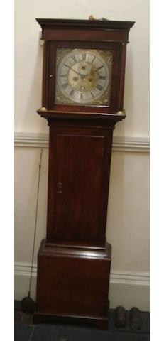 "A George III mahogany longcase clock, Ricd Penny London, the square hood with freestanding rounded columns, the trunk with a short door, the 12"" brass dial with silvered chapter ring, subsidiary seconds and calender aperture, ringed winding holes, the twin train movement striking on a bell, with key, 183cm."