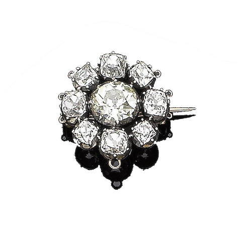 A diamond cluster brooch,