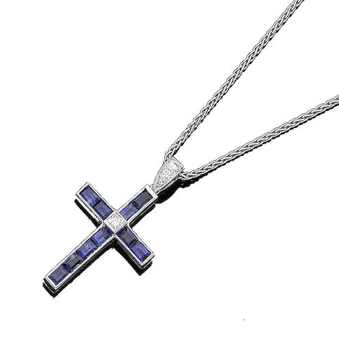 A sapphire and diamond cross pendant necklace