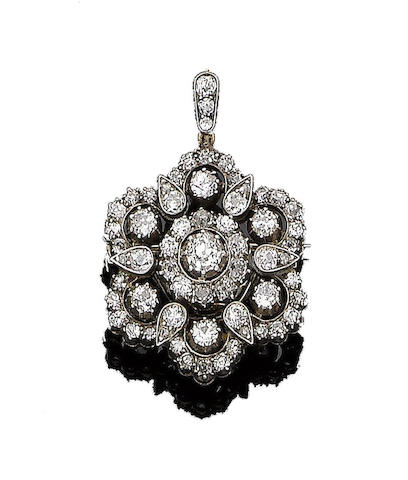 A diamond cluster pendant/brooch,