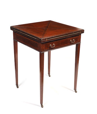 An Edwardian mahogany and crossbanded envelope card table