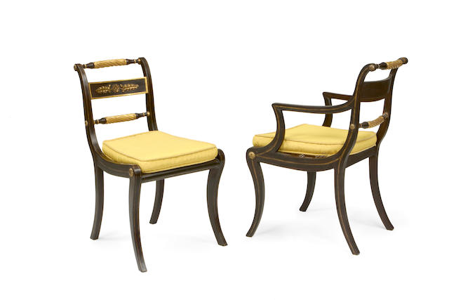 A set of eight Regency later decorated simulated rosewood and parcel gilt dining chairs