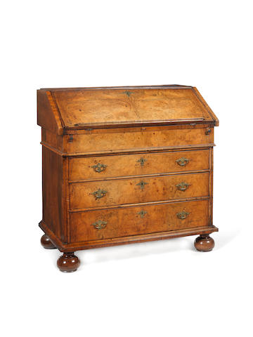 A William and Mary figured walnut and crossbanded bureau