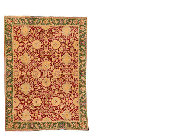An Agra design carpet, 482cm x 357cm