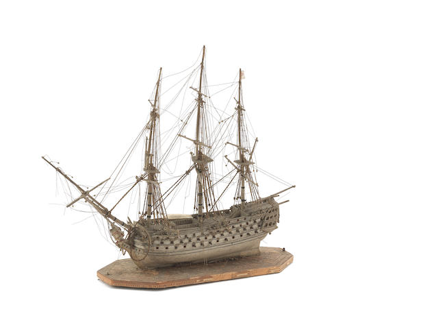 An early 19th century cased bone Prisoner of War ship model 11x8x4ins.(28x20x10cm)