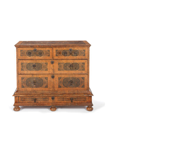 A William and Mary princeswood oyster veneered and walnut banded chest on stand