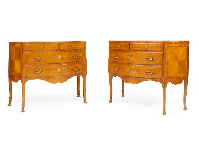 A pair of North Italian early 20th century rosewood serpentine commodes in the Louis XV style