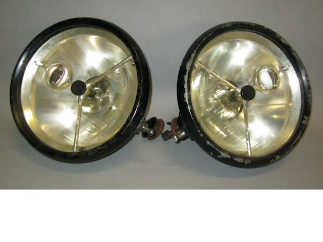 A pair of DB100 'bulls-eye' electric headlamps, British,