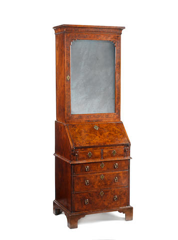 A small George I walnut, crossbanded and featherbanded bureau bookcase