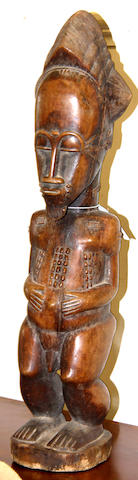 A Baule male figure, Ivory Coast