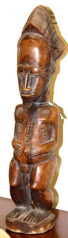 A Baule male figure, Ivory Coast