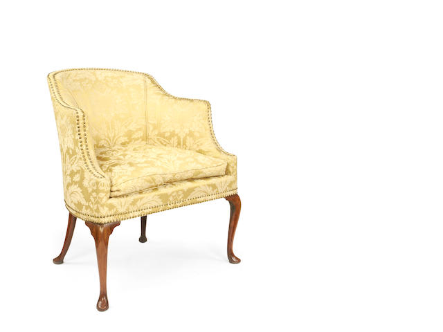 An unusual late 19th/early 20th century walnut tub back armchair in the George II style