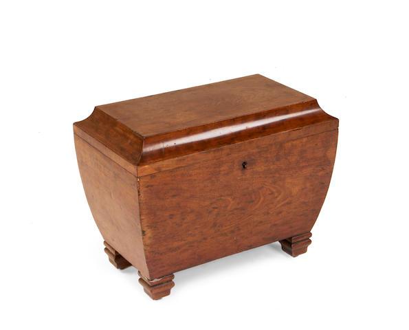 A North European second quarter 19th century plum pudding mahogany cellaret