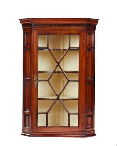 A 19th century mahogany glazed corner cabinet