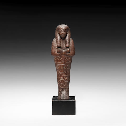 An Egyptian royal wood shabti of Seti I