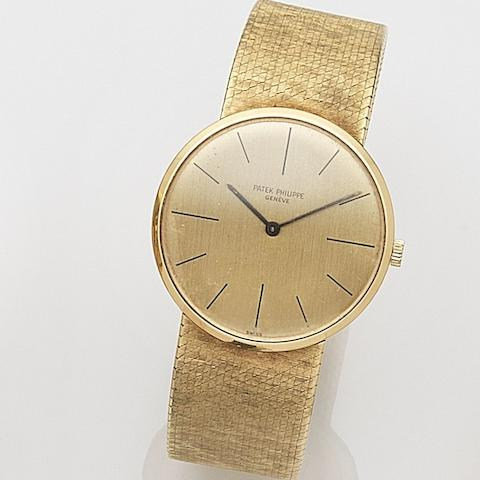 Patek Philippe. An 18ct gold manual wind bracelet watchRef:3513/1, Case No.2652133, Movement No.1137692, Circa 1968