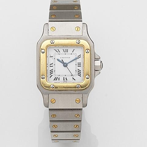 Cartier. A lady's stainless steel and gold automatic bracelet watchSantos Galbee, Case No.090232983, Circa 1990