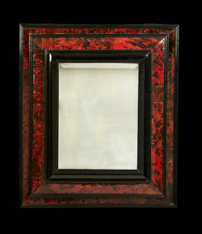A Dutch 19th century tortoiseshell and ebonised mirror in the late 17th/early 18th century style