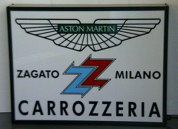An 'Aston Martin Zagato Milano Carrozzeria' illuminating sign,