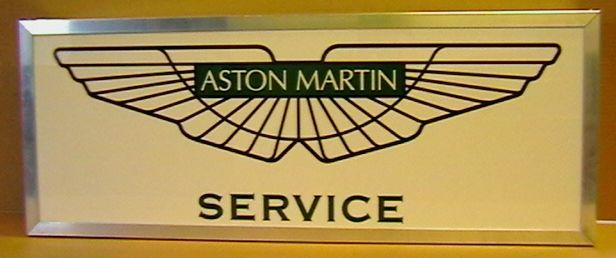 An Aston Martin Service illuminated sign,
