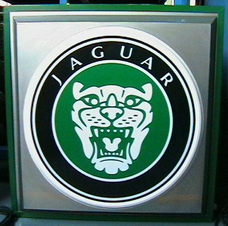A Jaguar illuminating garage sign,