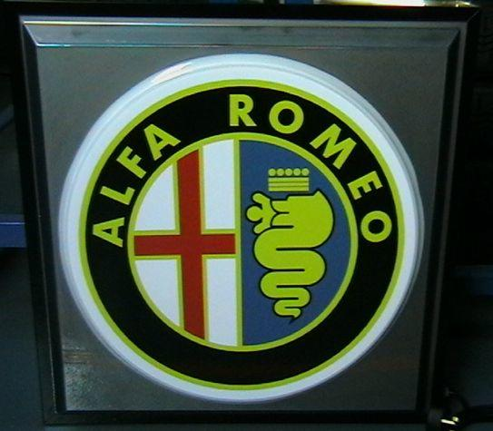 An Alfa Romeo illuminating garage sign,