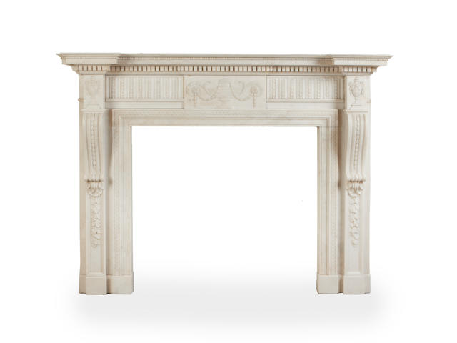 A late C19th carved carraea marble chimneypiece in the George III style